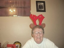 Mom, hamming it up at Christmas in 2003.